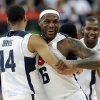 United States\' LeBron James and Anthony Davis celebrate after the men\'s gold medal basketball game at the 2012 Summer Olympics, Sunday, Aug. 12, 2012, in London. USA won 107-100. (AP Photo/Eric Gay)