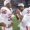 Oklahoma\'s Ronnell Lewis (56) and Joseph Powell (3) celebrate after the 23-20 win over Nebraska during the Big 12 football championship game between the University of Oklahoma Sooners (OU) and the University of Nebraska Cornhuskers (NU) at Cowboys Stadium on Saturday, Dec. 4, 2010, in Arlington, Texas. Photo by Chris Landsberger, The Oklahoman