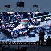 Photo - Race fans watch a video screen that shows Will Power, of Australia, pitting during the IndyCar auto race at Texas Motor Speedway in Fort Worth, Texas, Saturday, June 7, 2014. (AP Photo/Larry Papke)