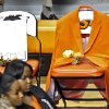 Coach Kurt Budkey\'s orange blazer hangs from a seat on the sideline during the memorial service for Oklahoma State head basketball coach Kurt Budke and assistant coach Miranda Serna at Gallagher-Iba Arena on Monday, Nov. 21, 2011 in Stillwater, Okla. Photo by Chris Landsberger