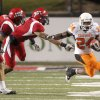 OSU\'s Kendall Hunter gets past Louisiana-Lafayette\'s Lance Kelley, left, and Devon Lewis-Buchanan during the football game between the University of Louisiana-Lafayette and Oklahoma State University at Cajun Field in Lafayette, La., Friday, October 8, 2010. Photo by Bryan Terry, The Oklahoman