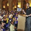 Minnesota Vikings quarterback Christian Ponder addresses supporters during a rally in the rotunda of the State Capitol where the Minnesota House was taking up a bill for a new stadium for the a new Vikings NFL football team Monday, May 7, 2012, in St. Paul, Minn. At right is Gov. Mark Dayton. (AP Photo/Jim Mone)