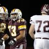 Clinton\'s Korbet Moore (2) and Dominic Ramirez celebrate a defensive play in front of Ada\' Cade Standford during the high school playoff game between Ada and Clinton at Putnam City High School in Oklahoma City, Friday, Nov. 23, 2012. Photo by Sarah Phipps, The Oklahoman