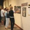 """During the opening reception of """"One Game, All Science"""" at Omniplex, Laura Berney and friend look at photos of the Edmond Soccer Club 93 Black team. Community Photo By: Carol Shanahan Submitted By: Carol, Edmond"""