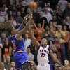 New York Knicks\' J.R. Smith (9) takes the game-winning shot over Phoenix Suns\' P.J. Tucker (17) during the second half of an NBA basketball game, Wednesday, Dec. 26, 2012, in Phoenix. The Knicks won 99-97. (AP Photo/Matt York)
