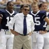 Penn State coach Joe Paterno watches their college football game against Coastal Carolina from the sideline with his three quarterbacks, Daryll Clark, left, Paul Cianciolo, second from right, and Pat Devlin right, Saturday, Aug. 30, 2008 at Beaver Stadium in State College, Pa. Paterno tied Florida State\'s Bobby Bowden atop the career wins list for major college coaches after No. 22 Penn State routed Coastal Carolina 66-10 on Saturday. Both Hall of Fame coaches now have 373 career wins apiece. (AP Photo/Carolyn Kaster)
