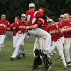 Winning pitcher Hunter Harrison of Hilldale leaps into the arms of his catcher, Jarrard Poteete as players rush onto the field from their dugout after the final out for Berryhill during the Class 4A state high school baseball championship game at Shawnee High School\'s Memorial Park. on Saturday,, May 12, 2012. The Hilldale Hornets defeated the Berryhill Chiefs, 2-1. Photo by Jim Beckel, The Oklahoman