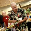 Photo - Jim Roberts, chairman of the Edmond Fish and Game Commission, goes through the food line at the annual appreciation dinner for Edmond employees and members of boards and commissions.
