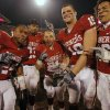 Oklahoma seniors Marcus Walker (24), Allen Patrick (23), Jacob Gutierrez (21), Joe Jon Finley (19) and Lewis Baker (16) celebrate with the Bedlam Trophy after the 49-17 win over Oklahoma State in the college football game between the University of Oklahoma Sooners (OU) and the Oklahoma State University Cowboys (OSU) at the Gaylord Family-Memorial Stadium on Saturday, Nov. 24, 2007, in Norman, Okla. Photo By CHRIS LANDSBERGER, The Oklahoman