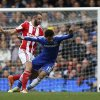 Photo - Chelsea's Mohamed Salah, right, is tackled by Stoke City's Marc Wilson during their English Premier League soccer match at Stamford Bridge, London, Saturday, April 5, 2014. (AP Photo/Sang Tan)