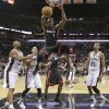 Miami Heat\'s Chris Bosh (1) dunks against the San Antonio Spurs during the first half at Game 4 of the NBA Finals basketball series, Thursday, June 13, 2013, in San Antonio. (AP Photo/Eric Gay)