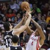 Houston Rockets\' Greg Smith (4) is fouled by Brooklyn Nets\' Kris Humphries (43) as Deron Williams (8) watches during the first half of an NBA basketball game Saturday, Jan. 26, 2013, in Houston. (AP Photo/Pat Sullivan)