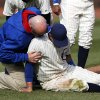 Photo - Chicago Cubs right fielder Justin Ruggiano is tended to during the ninth inning of a baseball game against the Arizona Diamondbacks at Wrigley Field in Chicago on Wednesday, April 23, 2014. (AP Photo/Andrew A. Nelles)