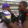 Photo - Cincinnati Bengals wide receiver A.J. Green (18) meets with Minnesota Vikings running back Adrian Peterson (28) after the Bengals defeated the Vikings 42-14 in an NFL football game, Sunday, Dec. 22, 2013, in Cincinnati. (AP Photo/David Kohl)