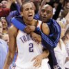 CELEBRATE / CELEBRATION: Oklahoma City\'s Thabo Sefolosha (2) gets a hug from Damien Wilkins after the NBA basketball game between the San Antonio Spurs and the Oklahoma City Thunder at the Ford Center in Oklahoma City, Monday, March 16, 2009. Oklahoma City won, 78-76. PHOTO BY NATE BILLINGS, THE OKLAHOMAN ORG XMIT: KOD
