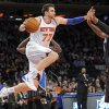 Photo - New York Knicks' Andrea Bargnani, left, drives under the basket as Orlando Magic center Glen Davis defends during the second quarter of an NBA basketball game on Friday, Dec. 6, 2013, at Madison Square Garden in New York. (AP Photo/Bill Kostroun)
