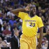 Golden State Warriors\' Draymond Green celebrates after scoring against the San Antonio Spurs during the first half of an NBA basketball game Friday, Feb. 22, 2013, in Oakland, Calif. (AP Photo/Ben Margot)
