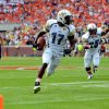 Photo -   Georgia Tech's Orwin Smith (17) heads to the end zone with a first-half touchdown while Robert Godhigh (25) begins to celebrate during an NCAA college football game against Clemson on Saturday, Oct. 6, 2012, at Memorial Stadium in Clemson, S.C. (AP Photo/ Richard Shiro)
