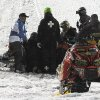 In this photo taken Jan. 24, 2013, emergency personnel tend to Caleb Moore after he crashed during the snowmoblie freestyle event at the Winter X Games in Aspen, Colo. Moore remains in critical condition in a Colorado hospital after this dramatic crash. A family spokeswoman reissued a statement Tuesday, Jan. 29, 2013, thanking fans, friends and family for their support and asked for continued prayers. They declined further comment. (AP Photo/The Colorado Springs Gazette, Christian Murdock) MAGS OUT