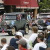 Parade goers watch as Model A\'s drive down Broadway during the LibertyFest Parade in downtown Edmond, OK, Saturday, July 4, 2009. By Paul Hellstern, The Oklahoman