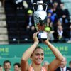 Sara Errani from Italy holds the trophy after her victory over Dominika Cibulkova during the final match of the Barcelona Ladies Open in Barcelona, Spain, Sunday, April 15, 2012. Errani won 6-2, 6-2. (AP Photo/Manu Fernandez) ORG XMIT: MF102