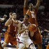 Oklahoma Sooner Isaiah Cousins (11) is guarded by Texas Longhorn\'s Javan Felix (3) and Cameron Ridley (55) in the second half as the University of Oklahoma Sooners (OU) men defeat the Texas Longhorns (TU) 77-65 in NCAA, college basketball at The Lloyd Noble Center on Saturday, March 1, 2014 in Norman, Okla. Photo by Steve Sisney, The Oklahoman
