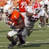 Photo - Oklahoma State's Dez Bryant (1) makes his way to the end zone for a touchdown past Georgia's Darius Dewberry (52)  during the college football game between OSU and the University of Georgia at Boone Pickens Stadium on the campus of Oklahoma State University in Stillwater Saturday, Sept. 5, 2009. Photo by Chris Landsberger, The Oklahoman. ORG XMIT: KOD