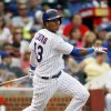 Photo - Chicago Cubs' Starlin Castro hits a double against the Philadelphia Phillies during the fourth inning of a baseball game on Saturday, Aug. 31, 2013, in Chicago. (AP Photo/Andrew A. Nelles)