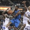 Dallas Mavericks guard Rodrigue Beaubois, of France, center, drives between Sacramento Kings\' John Salmons, left, James Johnson, right, and Isaiah Thomas, foreground right, during the first quarter of an NBA basketball game in Sacramento, Calif., Thursday, Jan. 10, 2013. (AP Photo/Rich Pedroncelli