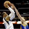 Photo - Dallas Mavericks guard Monta Ellis (11) shoots over Golden State Warriors guard Klay Thompson in the second half of an NBA basketball game, Tuesday, April 1, 2014, in Dallas. Golden State won 122-120 in overtime. (AP Photo/Matt Strasen)