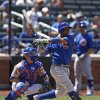Photo - Chicago Cubs' Luis Valbuena and New York Mets catcher Travis d'Arnaud watch Valbuena's sixth-inning, RBI single off New York Mets relief pitcher Dana Eveland in a baseball game at Citi Field in New York, Monday, Aug. 18, 2014. (AP Photo/Kathy Willens)