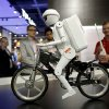 Photo - Murata Boy, a bicycle riding robot, rides a bike at the Murata booth at the at the International Consumer Electronics Show in Las Vegas, Tuesday, Jan. 8, 2013. (AP Photo/Jae C. Hong)