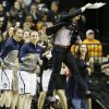 Photo - The Connecticut bench celebrates a basket against Stanford during the first half of the semifinal game in the Final Four of the NCAA women's college basketball tournament, Sunday, April 6, 2014, in Nashville, Tenn. (AP Photo/Mark Humphrey)