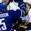 Photo - Vancouver Canucks' Brad Richardson, left, roughs up Nashville Predators' Ryan Ellis during the third period of an NHL hockey game in Vancouver, British Columbia, on Wednesday, March 19, 2014. (AP Photo/The Canadian Press, Darryl Dyck)