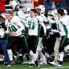 HIGH SCHOOL FOOTBALL / CELEBRATE / CELEBRATION: Tyler Fling (left) and Chad Kwasny (second left) join other McGuinness players as they rush the field after defeating Grove in the Class 4A semifinal football game in Bixby. SHERRY BROWN/Tulsa World Saturday, Nov. 29, 2008 ORG XMIT: 0811291945122918