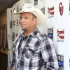 Garth Brooks appears at the Oklahoma Twister Relief Concert at the Gaylord Family-Oklahoma Memorial Stadium on Saturday, July 6, 2013 in Norman, Okla. (Photo by Alonzo Adams/Invision/AP)