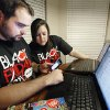 Travis Benham and his wife prepare for Black Friday by using newspaper adds, the internet and an iPhone app at their home in Mustang, Monday, November 21, 2011. Photo by David McDaniel, The Oklahoman