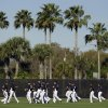 New York Yankees players run through the outfield during practice at baseball spring training, Monday, Feb. 20, 2012, in Tampa, Fla. (AP Photo/Matt Slocum)