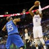 Oklahoma City\'s Caron Butler (2) shoots against Dallas\' Vince Carter (25) during an NBA basketball game between the Oklahoma City Thunder and the Dallas Mavericks at Chesapeake Energy Arena in Oklahoma City, Sunday, March 16, 2014. Photo by Nate Billings, The Oklahoman