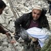 A Syrian man carries a child\'s body after a government airstrike hit the neighborhood of Ansari, in Aleppo, Syria, Sunday, Feb. 3, 2013. The Britain-based activist group Syrian Observatory for Human Rights, which opposes the regime, said government troops bombarded a building in Aleppo\'s rebel-held neighborhood of Eastern Ansari that killed over 10 people, including at least five children. (AP Photo/Abdullah al-Yassin)