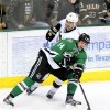 Photo - Dallas Stars left wing Jamie Benn (14) tries to control the puck in front of Pittsburgh Penguins left wing Tanner Glass (15) in the second period during an NHL hockey game, Saturday, Jan. 25, 2014, in Dallas. (AP Photo/Matt Strasen)