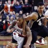 FILE- In this Dec. 13, 2012, file photo, Portland Trail Blazers guard Damian Lillard, left, battles for a loose ball with San Antonio Spurs forward Danny Green during the second half of an NBA basketball game in Portland, Ore. The Trail Blazers are expected to announce Lillard as the league\'s Rookie of the Year on Wednesday, May 1, 2013. (AP Photo/Don Ryan, File)