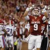 Oklahoma\'s Trevor Knight (9) celebrates after an Oklahoma touchdown during a college football game between the University of Oklahoma Sooners (OU) and the Louisiana Tech Bulldogs at Gaylord Family-Oklahoma Memorial Stadium in Norman, Okla., on Saturday, Aug. 30, 2014. Photo by Bryan Terry, The Oklahoman