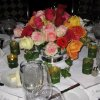 A HAPPY BIRTHDAY PARTY...Beautiful roses arranged by Trochtas\' floral designers decorated the dinner tables. (Photo by Helen Ford Wallace).
