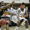 Oklahoma State guard Marcus Smart (33) passes past Portland State guard Lateef McMullan, left, in the first half of an NCAA college basketball game in Stillwater, Okla., Sunday, Nov. 25, 2012. Oklahoma State won 81-58. (AP Photo/Sue Ogrocki)