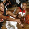 Norman\'s Ashley Bruner (12), left, and Del City\'s Toni Young (15) chase a loose ball during the girls high school basketball game between Del City and Norman in Del City, Okla., Tuesday, Dec. 4, 2007. Del City won, 60-52. By Nate Billings, The Oklahoman
