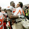 CELEBRATE, CELEBRATION: Russell Okung of OSU celebrates with Larry Fedora after their win in the college football game between Oklahoma State University (OSU) and the University of Nebraska at Memorial Stadium in Lincoln, Neb., on Saturday, Oct. 13, 2007. By Bryan Terry, The Oklahoman ORG XMIT: KOD