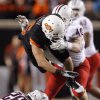 Oklahoma State\'s Josh Cooper is tackled by Arizona\'s Derek Earls (40) and Jourdon Grandon (26) during their game Thursday night. PHOTO BY SARAH PHIPPS, The Oklahoman