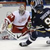 St. Louis Blues\' Vladimir Tarasenko, of Russia, shoots just wide of Detroit Red Wings goalie Petr Mrazek, left, of the Czech Republic, during the second period of an NHL hockey game Thursday, Feb. 7, 2013, in St. Louis. (AP Photo/Jeff Roberson)