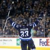 Photo - Winnipeg Jets' Dustin Byfuglien (33) celebrates his second period goal against the Dallas Stars' during NHL hockey action at the MTS Centre in Winnipeg, Sunday, March 16, 2014. (AP Photo/The Canadian Press, Trevor Hagan)
